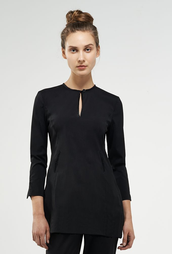 florence roby model wearing a black tunic